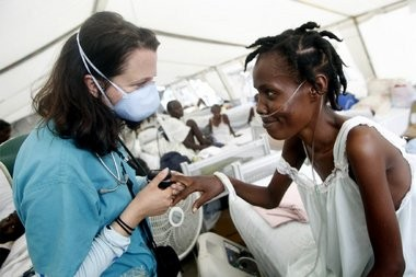 Megan Coffee checks the vitals of a Haitian patient while making rounds in the tuberculosis ward of the hospital in Port-au-Prince in this file photo. Columnist Bob Braun covered the earthquake in Haiti in 2010.