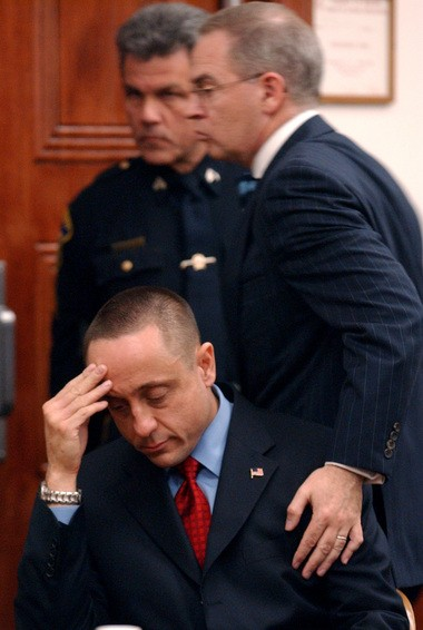 The Rev. Michael Fugee was found guilty in Bergen County Superior Court on April 11, 2003, of fondling a teenage boy. Defense attorney Brian J. Neary pats Fugee, seated, on the shoulder as he proceeds to the judge's bench after the verdict. The verdict was later overturned by the state appellate court.