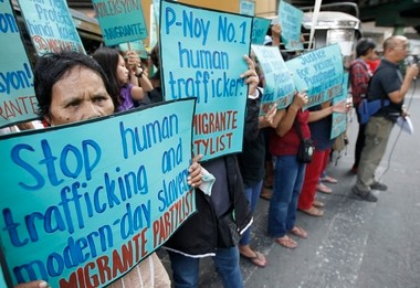 Filipinos demonstrate outside the Philippine Overseas Employment Administration in Mandaluyong City, east of Manila, Philippines, on Feb. 21, 2013. Labor rights group 'Migrante' (Migrant) called for intensified government efforts against human trafficking and employer abuse of overseas Filipino workers.