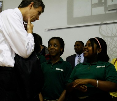 U.S. Secretary of Education Arne Duncan talks to Lucy Yeboah and Ryana Cole, sixth graders, during an assembly at North Star Academy charter school in Newark in 2009.