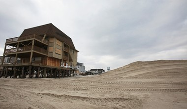 The end of the dunes being rebuilt by Toms River at the end of 5th Avenue on Friday, January 4, 2013, in Ortley Beach, NJ. The beach front property past the dunes is privately owned and owners are refusing the town permission to rebuild and build up the dunes following Hurricane Sandy.