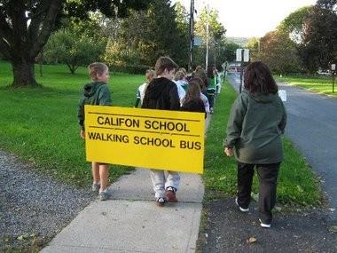 Students walk to school on International Walk to School Day.