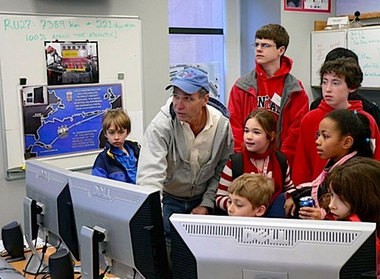 Rutgers has one of the world's most advanced ocean observatories for integrated research and education. Here Professor Scott Glenn works with students in the cool room.
