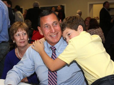 U.S. Rep. Frank LoBiondo gets a hug from his grandson, as he awaits results of his 2014 re-election campaign. Pictured also is his chief of staff, Mary Annie Harper. LoBiondo believes in representing the people in his district.
