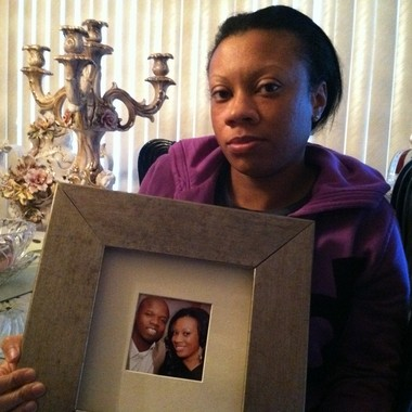 Candice Clervoyant holds a photo of her husband, Pierre Clervoyant Jr., who was one of the victims in the Christmas triple homicide at an Irvington go-go bar.