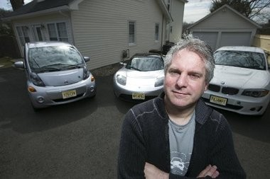 Michael Thwaite with his fleet of electric vehicles.