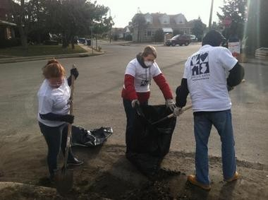 Volunteers with the nonprofit group Jersey Cares clean out debris from Hurricane Sandy on Pelican Island, a section of both Toms River and Berkeley Township, as part of a community service project for Martin Luther King Jr. Day.