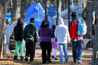 Residents of the Lakewood tent city walk to the chapel in this December 2011 photo.