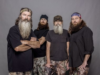 "This 2012 photo released by A&E shows, from left, Phil Robertson, Jase Robertson, Si Robertson and Willie Robertson from the A&E series, ""Duck Dynasty."""