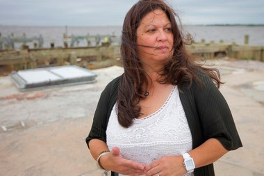 "Aneglita ""Gigi"" Liaguno-Dorr, owner of JakeaBob's Bay in Union Beach, stands in the area where her original restaurant once stood before it was destroyed by Hurricane Sandy."