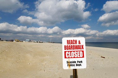 A police sign announces the empty beach east of the Sawmill Cafe in Seaside Park closed. A massive fire here wiped out four blocks of boardwalk attractions in September.