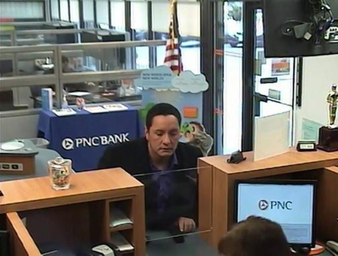 After the robbery in Toms River, police released a surveillance photograph that shows Michael Cassano at the teller's window. (Toms River Police Department)