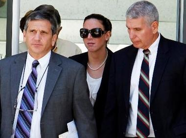 Erica DePalo (center) pictured leaving the Superior Courthouse in Newark.