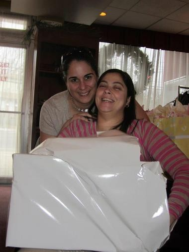 Jenn and Carly, pictured here at their baby shower, celebrating the upcoming birth of their daughter.