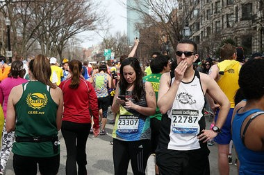 Runners react near Kenmore Square after two bombs exploded during the 117th Boston Marathon on April 15, 2013 in Boston, Massachusetts.