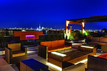 Park Bayonne's rooftop lounge and patio provide views of the waterfront and New York City.