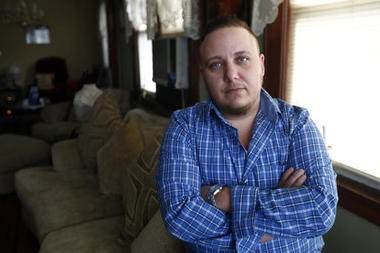Jionni Conforti poses for The Associated Press in his home, Thursday, Jan. 5, 2017, in Totowa, N.J. The transgender man has sued St. Joseph's Regional Medical Center in Paterson, N.J., after he said it cited religion in refusing to allow his surgeon to perform a hysterectomy procedure he said was medically necessary as part of his gender transition. (AP Photo/Julio Cortez)