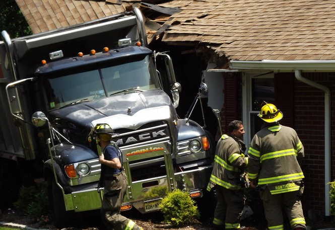 The dump truck caused major damage to the Sunrise Drive home June 18, 2018