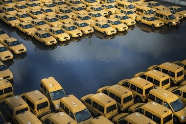 New taxi cabs in a flooded lot in Hoboken, two days after Hurricane Sandy made landfall.