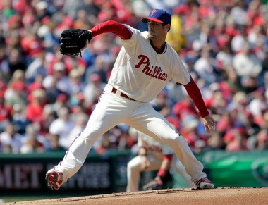 Phillies starting pitcher Cole Hamels throws against the Kansas City Royals in the first inning of Sunday's game.