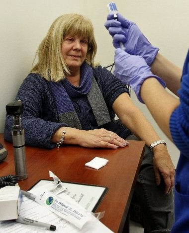 """Arlene Yaeger gets ready for a flu shot at Partnership Health Center, the """"medical home"""" for Toms River school district employees and their families."""