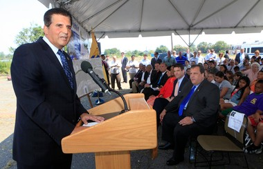 Essex County Executive Joseph DiVincenzo speaks in 2011. Gov. Chris Christie, seated, listens.