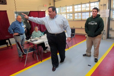 Gov. Chris Christie waves goodbye to election workers after voting with his son Andrew (right) at the Mendham Emergency Services Building in 2011.