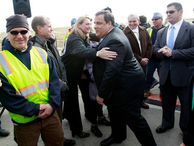 Maggie Moran, a Democratic political operative who was former Gov. Jon Corzine's chief of staff and campaign manager, has emerged as force in helping AshBritt Inc. land lucrative debris removal contracts in towns stricken by Hurricane Sandy. Here, she greets Gov. Chris Christie as he visits Belmar for the groundbreaking of the borough's new boardwalk last month in the wake of Hurricane Sandy.