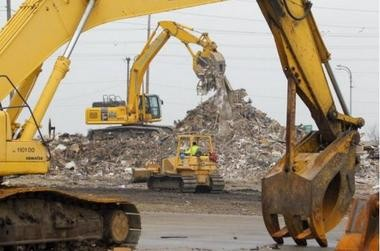 The chairman of the Assembly Budget Committee said Sunday he planned to look into a $100 million no-bid contract the state signed with a Florida debris-removal company after Hurricane Sandy. Heavy equipment contracted by AshBritt, Inc. piles debris being collected in a temporary dump at the base of the Rt. 37 bridge in Seaside Heights.