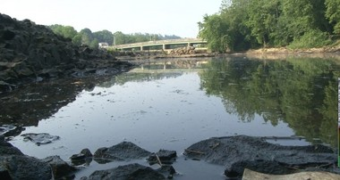 The state Attorney General and Department of Environmental Protection on Tuesday announced companies will pay the state $130 million to settle a lawsuit concerning pollution in the Passaic River, seen here in this photo taken in Passaic County. Gov. Chris Christie said today he hasn't decided what to do with the money.