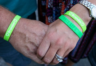The Holts wear bracelets bearing Brandon's name to remember their son.