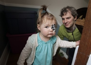 Vivian Wilson, 2, with her father, Brian Wilson in their Scotch Plains home in May, wears an eye patch to prevent seizures. She is diagnosed with Dravet syndrome, a potential deadly form of epilepsy. Her family fought for the passage of a bill that would reduce some of the restrictions minors face in the state's medical marijuana program.