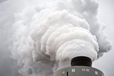 The cap-and-trade program, also known as RGGI, involved 10 states in the Northeast that has banded together in hopes of cut carbon dioxide emissions at power plants. Steam rises from the stack of the scrubber as the primary emission after the cleaning process ata coal-fired power plant outside Baltimore, Maryland, in this 2011 photo.