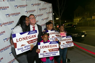 Lonegan stops for a photo with Minnie Cuebas, left, of Irvington, and her daughters, from left, Deborah, Diamond and Destiny