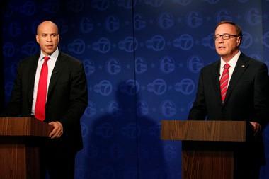 Democrat Cory Booker (left) and Republican Steve Lonegan participate in Trentonin the first debate of New Jersey's special U.S. Senate election.