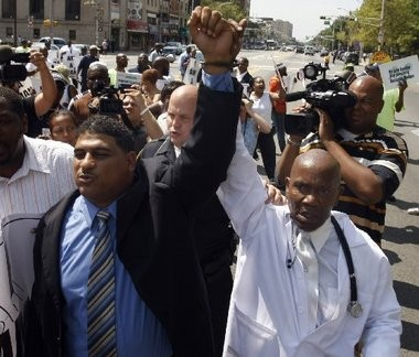 Rahaman Muhammad, pictured left in this 2010 file photo, was part of a group of young reformers in Newark that included Cory Booker.