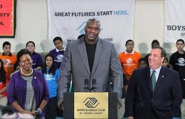 Former NBA star Shaquille O'Neal speaks as Gov. Chris Christie, right, and Camden Mayor Dana Redd laugh, at the Boys and Girls Club of East Camden's Social Recreation Area Oct. 10.