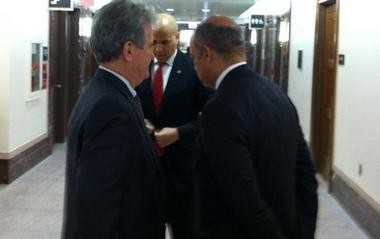 Sen. Booker confers with DHS nominee Jeh Johnson and Sen. Tom Coburn (R-OK) before Johnson's confirmation hearing.