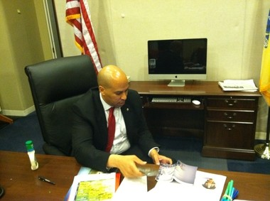 Sen. Booker sits in his new office in the Senate Hart Office building.