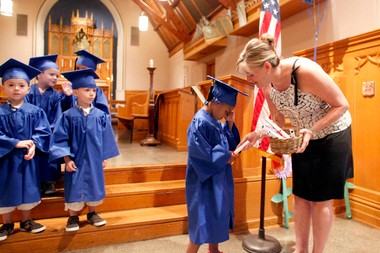 A shy student received her diploma. Preschool graduation at Madison Day Care Center in May. The Adovcates for Children of New Jersey released a report today that urged lawmakers to find ways to make child care more affordable and its quality easier to measure.