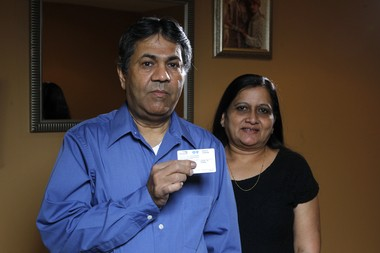The state confirmed this week it has parted ways with HP, the company that was creating a new information tracking system that would help alleviate a backlog in the Medicaid program. In this file photo from April, Dhiru Dhebaria, left, and his wife Bharatiben Dhebaria, at home in Edison, discuss how she was caught up in that backlog when she applied for Medicaid under Obamacare.