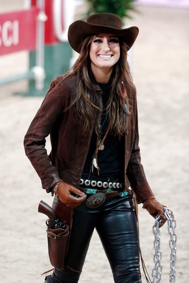 "American show jumper Jessica Springsteen, daughter of rock star Bruce Springsteen, smiles prior to attend the equestrian ""Style and Competition for Amade"" in Villepinte, east of Paris, Saturday, Dec. 6, 2014. (AP Photo/Thibault Camus)"