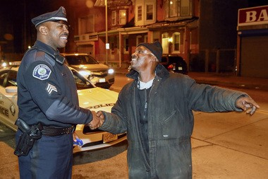 Sgt. Duwan Pearson chats with Rick Anderson while on patrol during in Camden County Police.