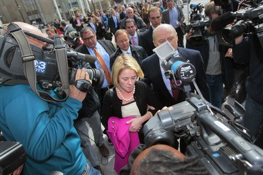 Bridget Anne Kelly, accompanied by attorney Michael Critchley, leaves the Mercer County Courthouse in Trenton in March 2014. A legislative panel went to court seeking her texts and emails. (File photo)
