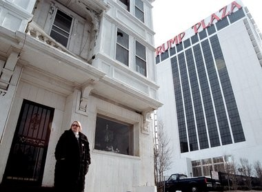 Vera Coking stands in front of her Columbia Place home in the shadow of Trump Plaza in 1996.