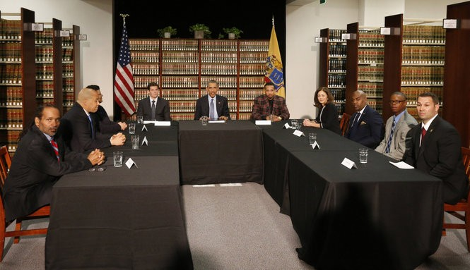 President Barack Obama leads a discussion at the Rutgers-Newark Center for Law and Justice with David Forem and Dquan Rosario.