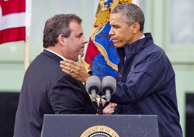 N.J. Gov. Chris Christie (left) introduces President Barack Obama at an appearance on the Asbury Park boardwalk outside Convention Hall. 5/28/13