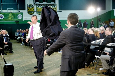 Prior to taking the audience's questions at town halls, Gov. Christie takes off his jacket and throws it to an aide. New Jersey Governor Chris Christie's 137th Town Hall Meeting In Sparta at the Sussex County Technical School. Thursday May 14, 2015.