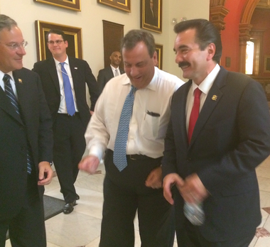 Assembly Minority Leader Jon Bramnick (D-Union), left, Gov. Chris Christie and Assembly Speaker Vincent Prieto (D-Hudson) clown around outside the governor's office just after midnight Tuesday. They emerged after privately discussing a potential sale tax cut and gas tax increase to fund road projects. (Sean Sullivan | NJ Advance Media)