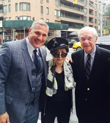 Attorney Michael Wildes (left) and his father, attorney Leon Wildes (right), are photographed recently with Yoko Ono.